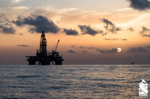 Oil rig with sunset in the Gulf of Mexico