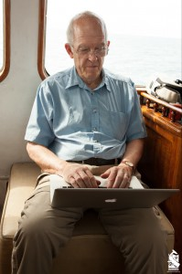Roger Payne writing on the RV Odyssey